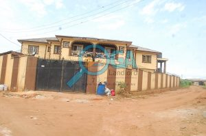 Landmark - A Compound with 3 Bungalows and an Upstairs Foundation for Sale at Igbogbo, Ikorodu, Lagos 1